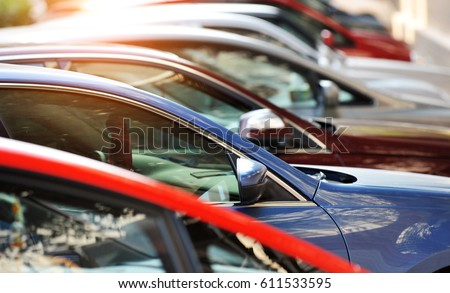 Group of cars parked in a row  Royalty-Free Stock Photo #611533595
