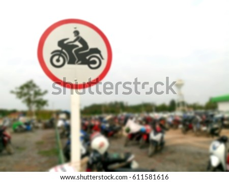 Road sign for parking motorbikes only. Motorcycle Parking Area in Thailand. Blurred Style background.