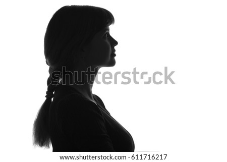 black and white silhouette of Profile portrait of head of a young woman looking up #611716217