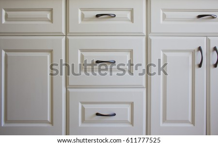 All white kitchen cabinets and drawers. Royalty-Free Stock Photo #611777525