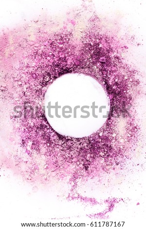 Traces of pink and purple makeup powder forming a frame. A vertical template for a makeup artist's business card or flyer design, with copy space. Toned image