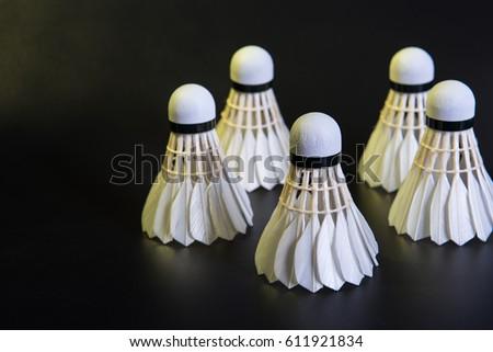 Five white badminton on black background. #611921834