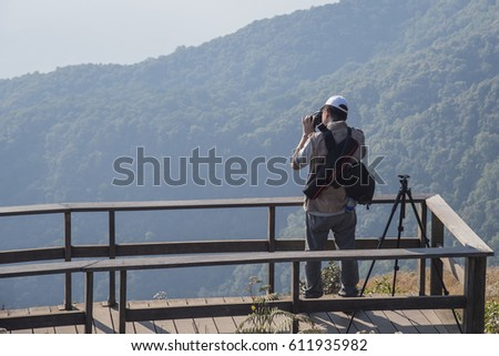 Photographer taking photo at Kew Mae Pan Chiangmai, Thailand #611935982