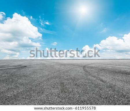 Asphalt road and sky cloud scenery #611955578