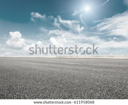 Asphalt road and sky cloud scenery #611958068