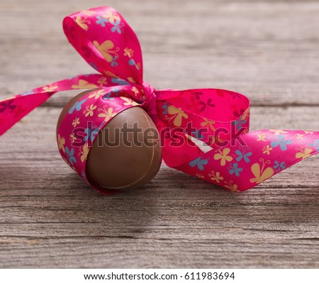 Chocolate Easter Eggs Over Wooden Background #611983694