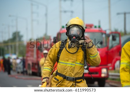 firefighters at work in oxygen suit #611990573