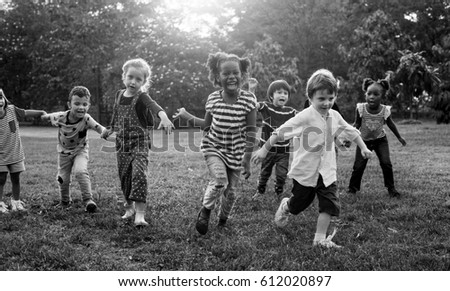 Group of kindergarten kids friends playing playground fun and smiling #612020897