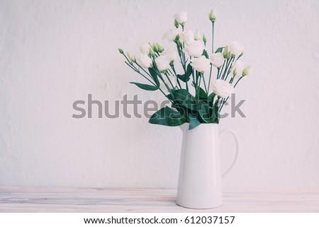 White roses in jar  #612037157