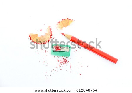 crayon or pencil and sharpener isolated on White Background Royalty-Free Stock Photo #612048764