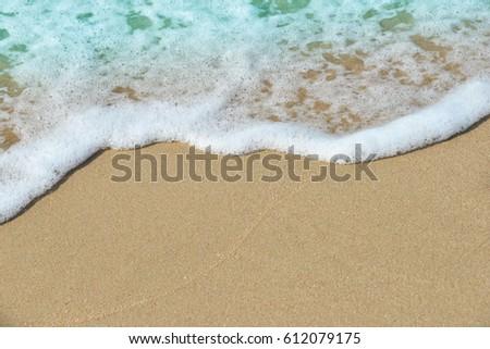 Soft waves of sea on sandy beach #612079175
