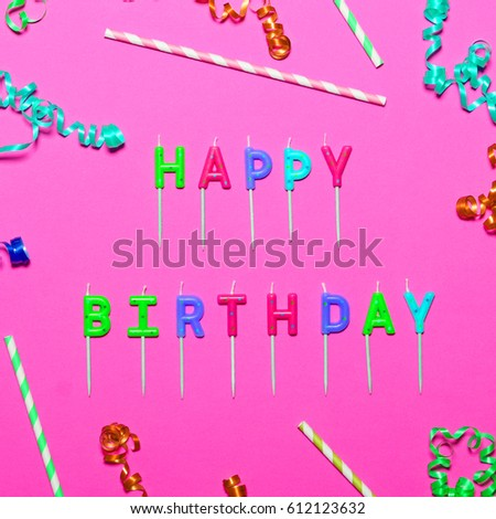 Happy Birthday flat lay party decorations on pink background
