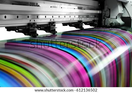 Large printer format inkjet working Royalty-Free Stock Photo #612136502