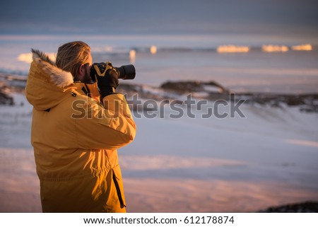 Antarctic Explorer Taking Pictures of Glacier