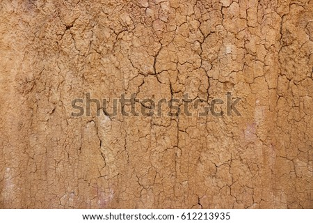 top view cracked  red soil ground Earth for texture background,desert cracks,Dry Orange surface Arid,drought land,Picture of natural disaster. drought land Caused by global warming and deforestation.. #612213935