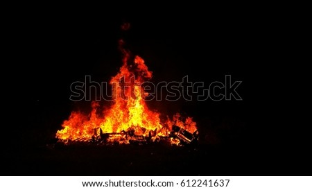 Open burning at night. Environmental Hazard #612241637