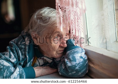 Old woman is sad emotions the home. Royalty-Free Stock Photo #612256466