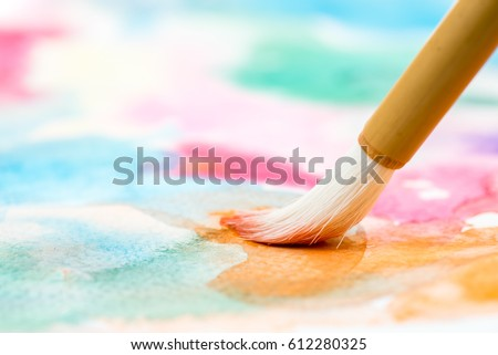 bamboo brush on abstract watercolor painting Royalty-Free Stock Photo #612280325