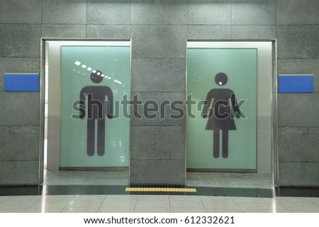 Way to restroom man and women toilet sign