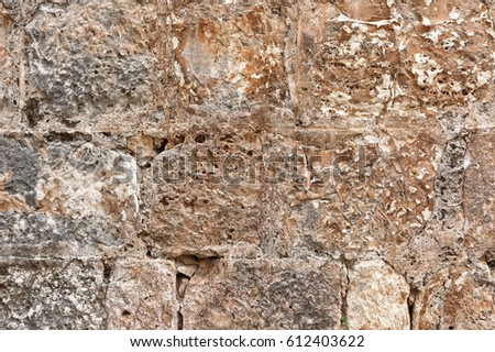 Old sandstone background. Rough stone Jerusalem wall surface texture #612403622