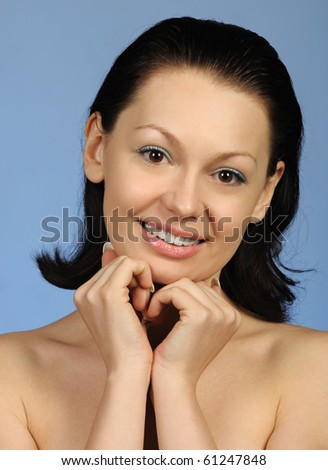 The beautiful young woman. Natural beauty. It is isolated on a blue background #61247848