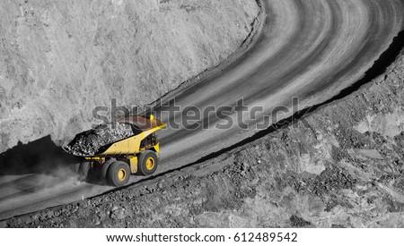 Modern Gold Mine in Kalgoorlie, Western Australia. Large truck transports gold ore from the Super Pit, Open cast mine. #612489542