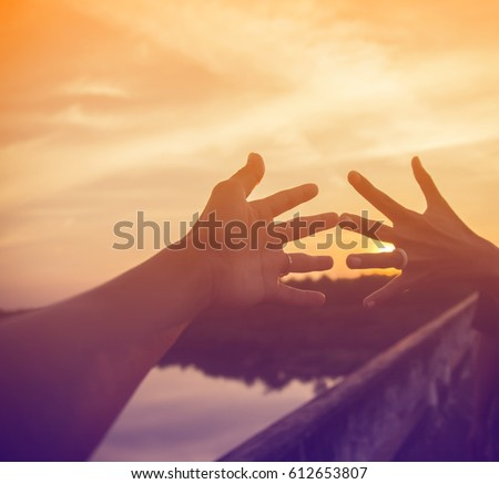 The hands of a couple in the sunset. #612653807