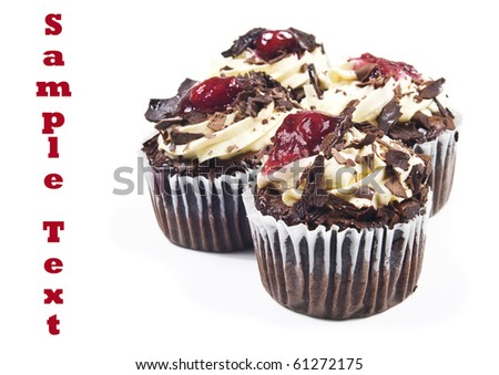 Four chocolate cupcakes - focus on the  top of the front cup cake #61272175