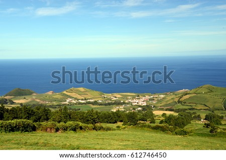 """the azores, island san miguel: view from the lookout point """"visto do rei"""" to the volcanic crater """"sete cidates"""" with the seas lagoa azul and lagoa verde, with typical flowers #612746450"""