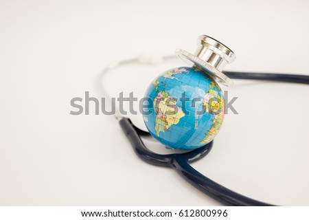 Globe with a stethoscope wrapped around it. Save the wold/ Green Earth day concept. Royalty-Free Stock Photo #612800996