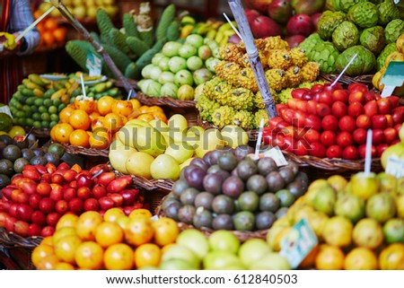 Fresh and ripe exotic fruits on traditional farmer market Mercado dos Lavradores, Funchal, Madeira island, Portugal #612840503