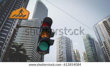 Green traffic light in the city with yellow cross walk street sign and urban cityscape in background. Traffic light and city concept in vintage style..