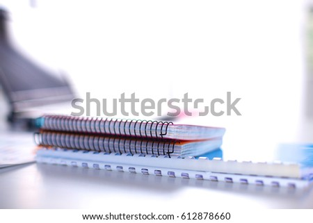 Office table with blank notepad and laptop #612878660