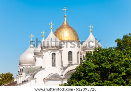 Domes of Saint Sophia cathedral against the blue sky in Great Novgorod, Russia #612895928
