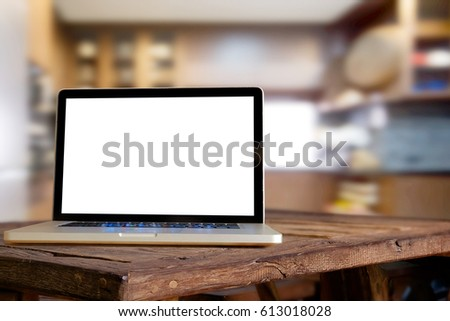 Laptop on rustic wood table in kitchen room. for display montage. #613018028