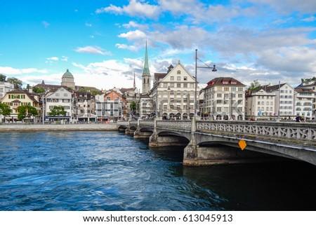 ZURICH, SWITZERLAND, JUNE 17, 2016: View of one of the bridges over the Limago river in the evening in Zurich, Switzerland on June17, 2016. #613045913