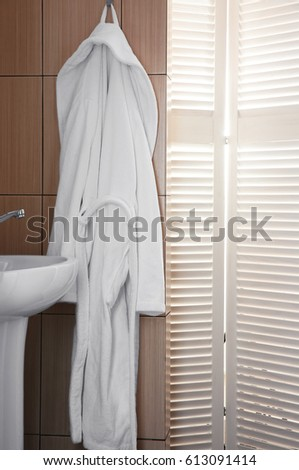 Bathrobe hanging on hook at spa salon #613091414