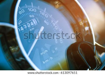 Round speedometer macro. The white arrow on the speedometer. The odometer Royalty-Free Stock Photo #613097651