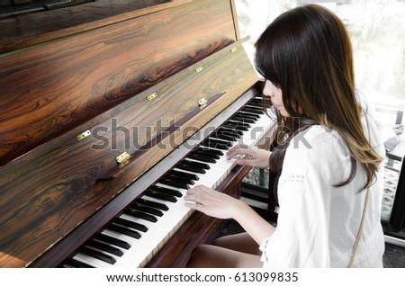 asian women playing piano #613099835
