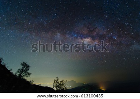 milky way galaxy, long exposure photograph with grain, image contain certain grain or noise and soft focus. color tone effect #613100435