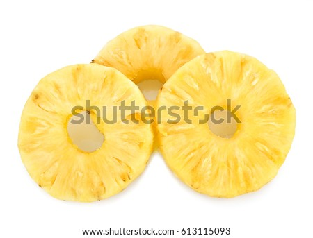 A cut slice of pineapple fruit isolated on white background #613115093
