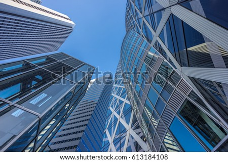 Tokyo, August 31, 2016. Ground level view of Mode Gakuen Cocoon Tower educational facility, Shinjuku I-Land Tower and Sompo Japan Building. located in the Nishi-Shinjuku district, Tokyo, Japan. #613184108