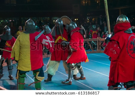 "MOSCOW - DECEMBER 03, 2016: Armored fighters , dressed as knights, fighting at the XI World championship in Medieval combat CUP ""DYNAMO"". in the Olympic Center. Znamensky #613186817"