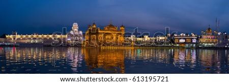 The Golden Temple at Amritsar, Punjab, India, the most sacred icon and worship place of Sikh religion. Illuminated in the night, reflected on lake.  Royalty-Free Stock Photo #613195721
