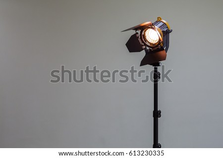 Spotlight with halogen bulb and Fresnel lens. Lighting equipment for Studio photography or videography. #613230335