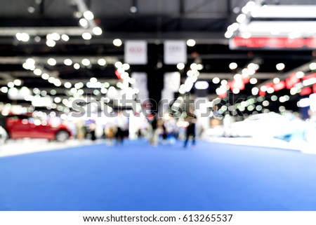 Blurred, defocused background of public event exhibition hall, business trade show concept #613265537