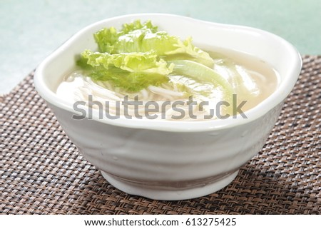noodles or vermicelli in soup with meat #613275425