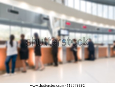 Blurred customer transaction in bank counter background #613279892