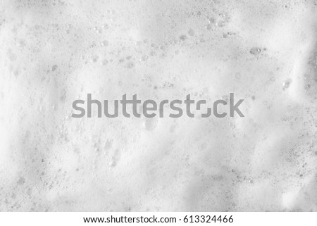Foam bubble from soap or shampoo washing on top view Royalty-Free Stock Photo #613324466