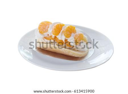 Orange topped on pancakes. #613415900